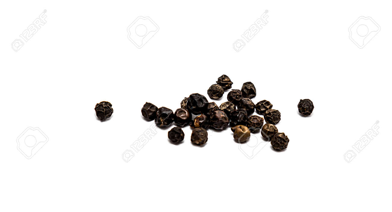 Peas of black allspice close-up on a white background. - 155722705
