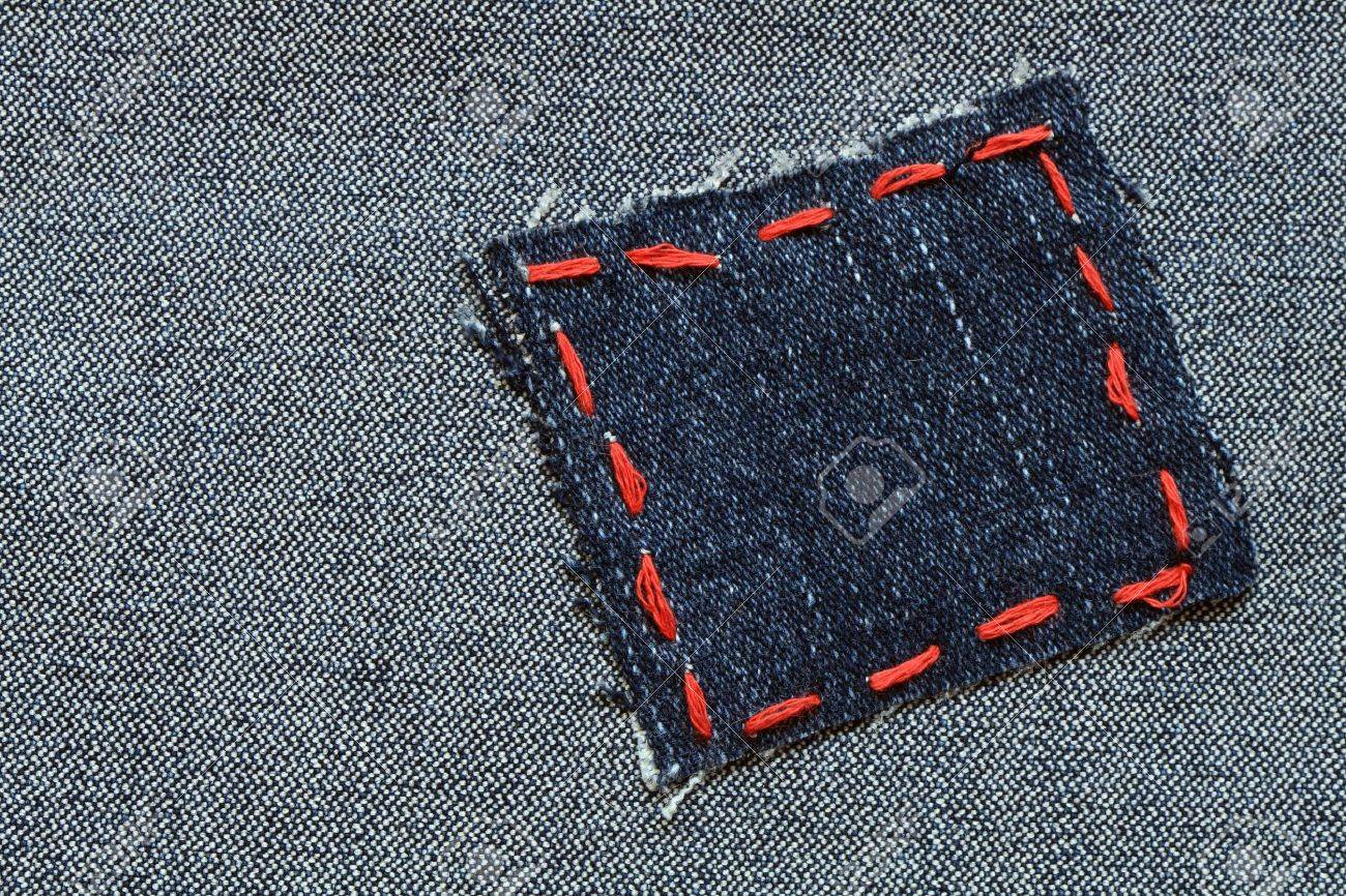 Patch with red thread attached on jeans textured Stock Photo - 6640171