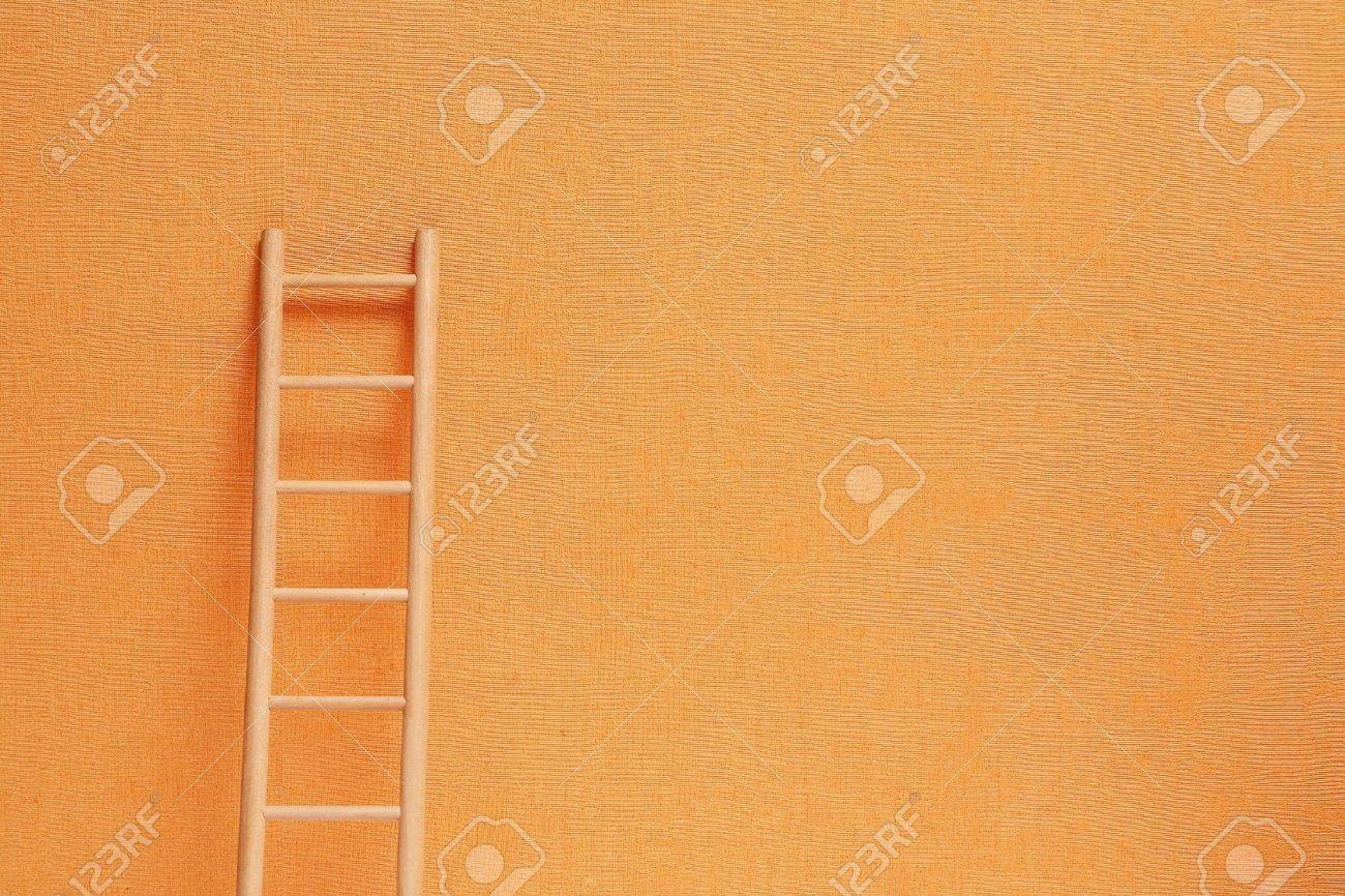 Conceptual background with wooden ladder against ginger wall Stock Photo - 7597637