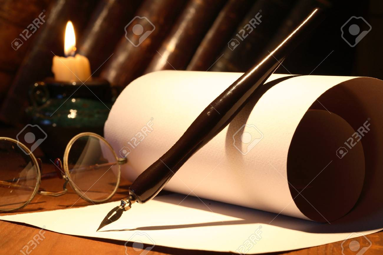 Scroll and old spectacles and ink pen near lighting candle on wooden surface Stock Photo - 9390582