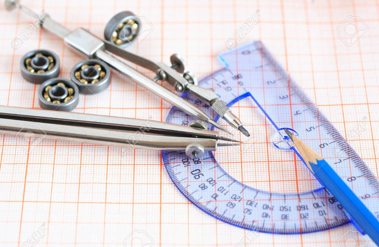 engineering concept drawing instrument and rulers on graph paper