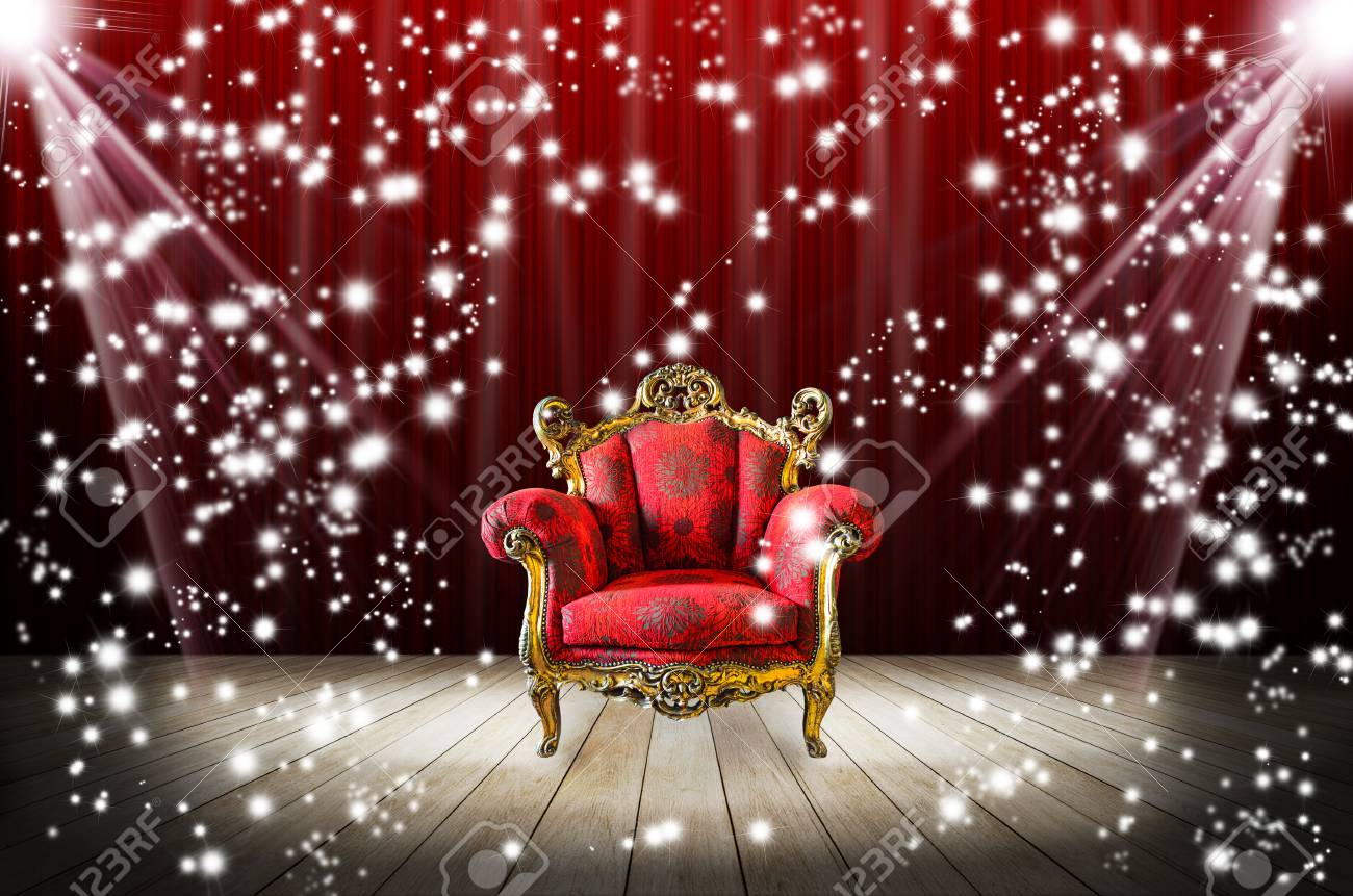 Red sofa in dark room with stage light on it