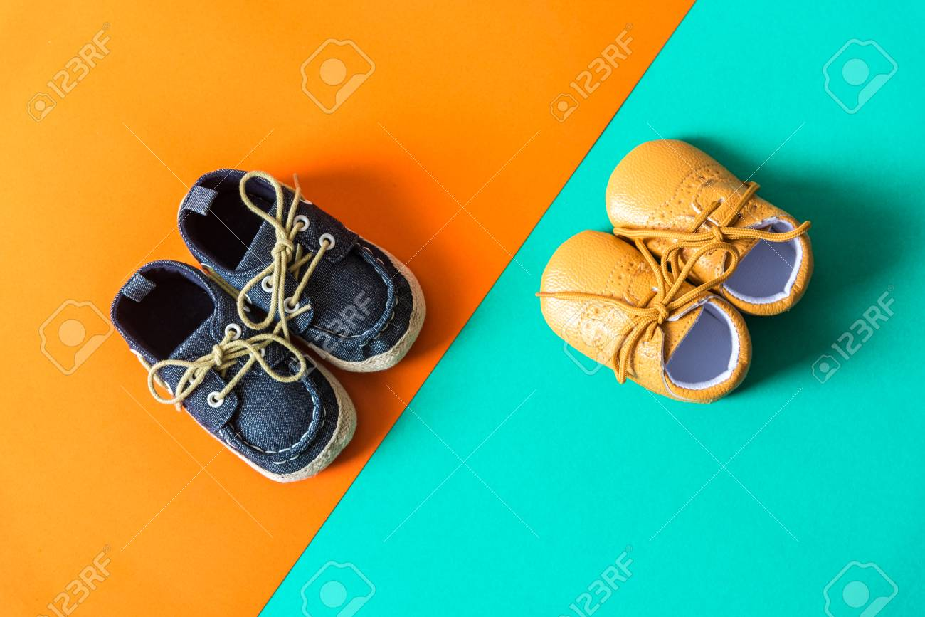 35ee2f5840e kids fashion shoes on orange green paper background Stock Photo - 92747436