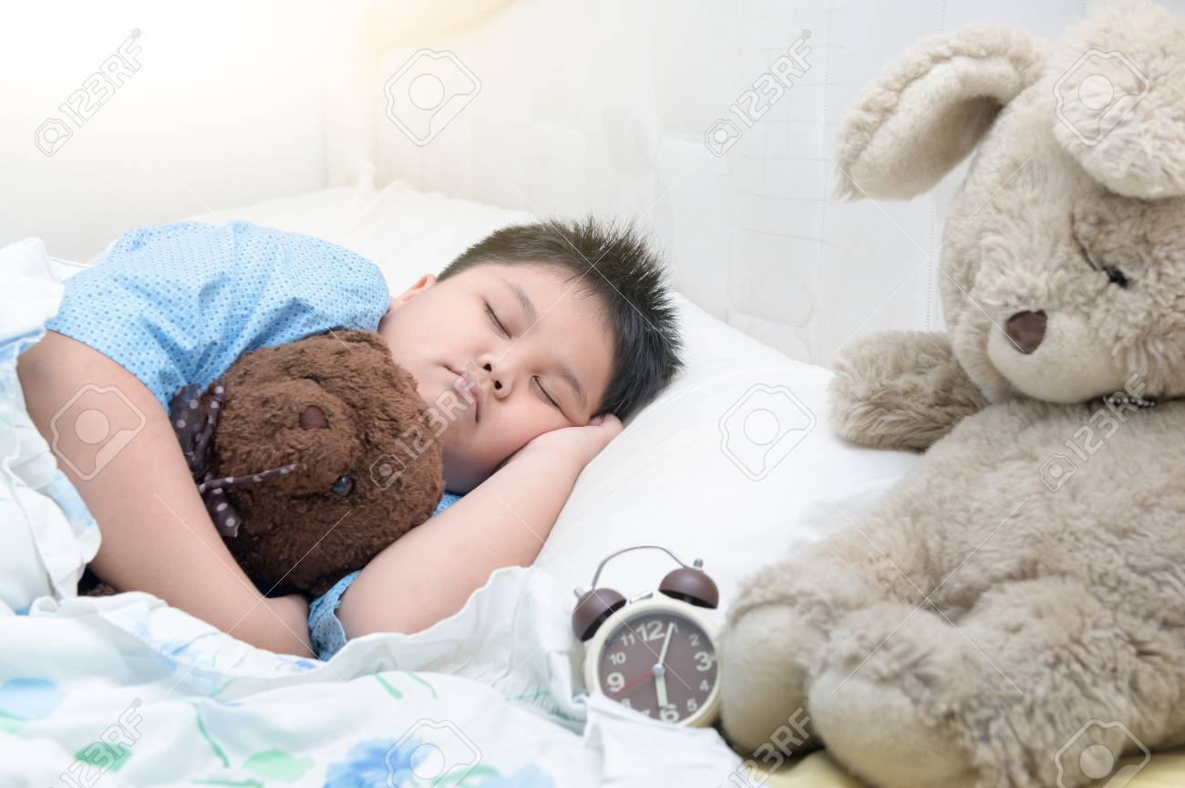 Obese fat boy sleep on bed stock photo 68451954