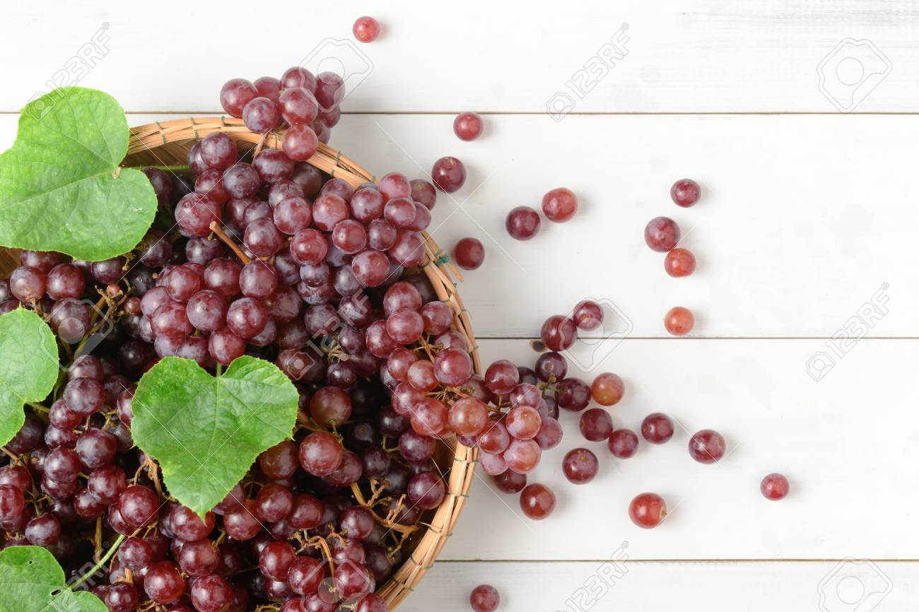 Fresh Champagne Grapes On Bamboo Basket And Vintage White Background..  Stock Photo, Picture And Royalty Free Image. Image 87403987.