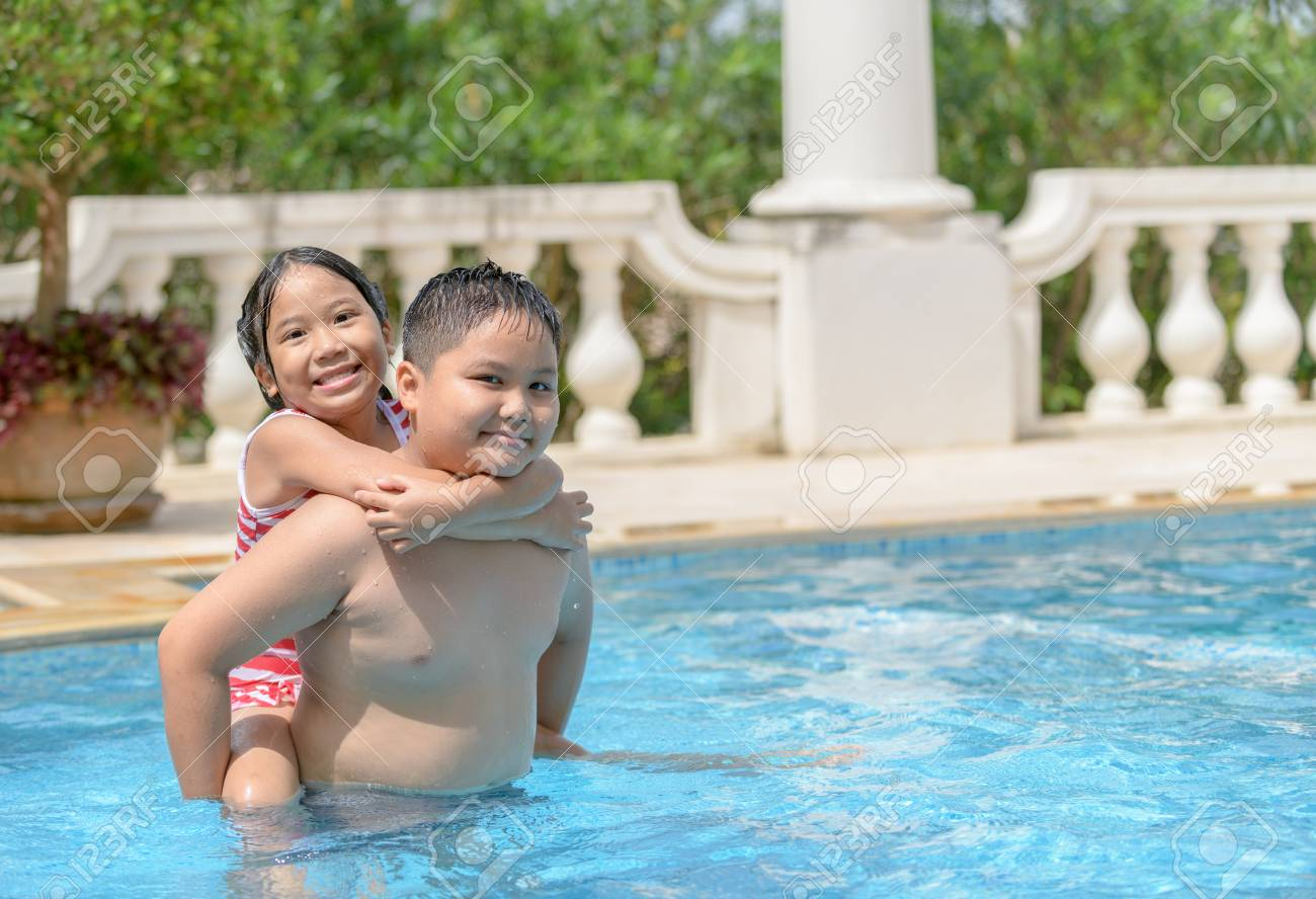 Happy brother and sister play in swimming pool, Healthy and exercise..