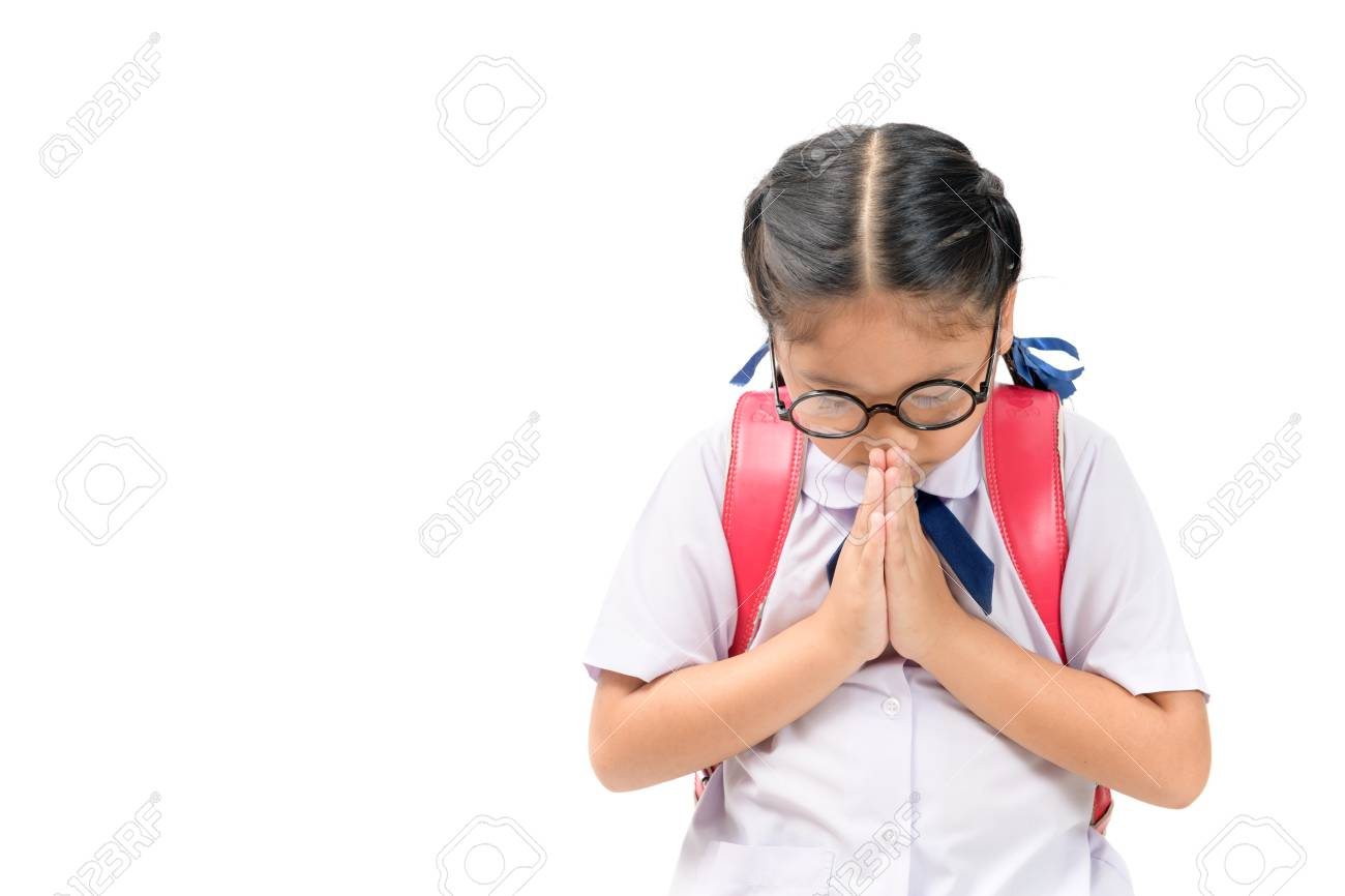 b6fbede05 asian child in school uniform and backpack with traditional greeting of  Thailand on white background isolated