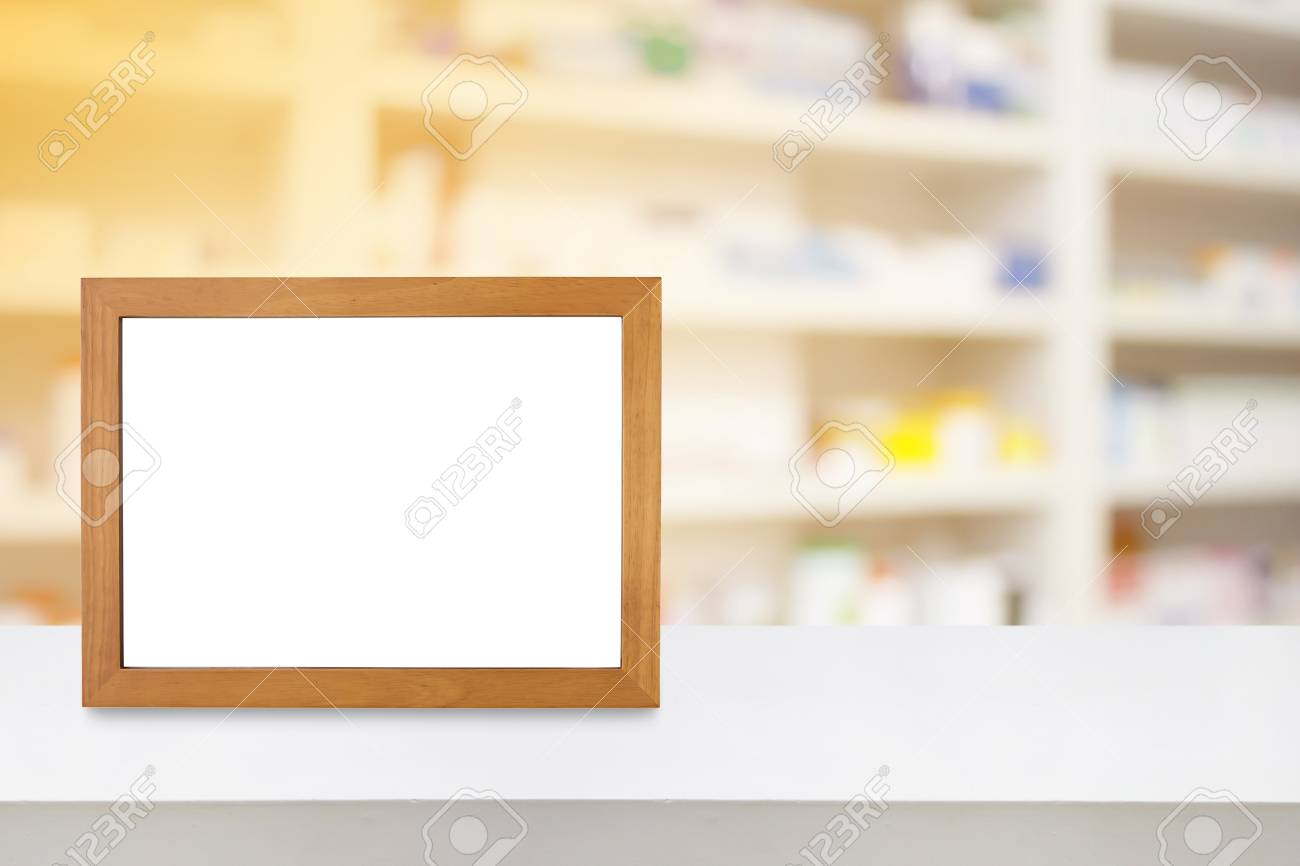 Wood Photo Frame On The Pharmacy Counter Over Blur Shelves Of ...