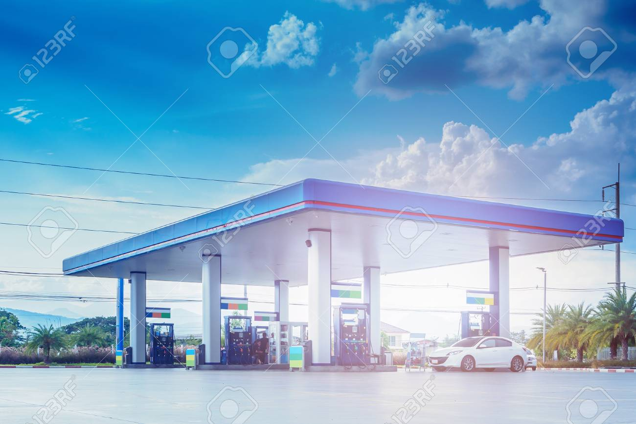 Gas fuel station with clouds and blue sky - 80995405