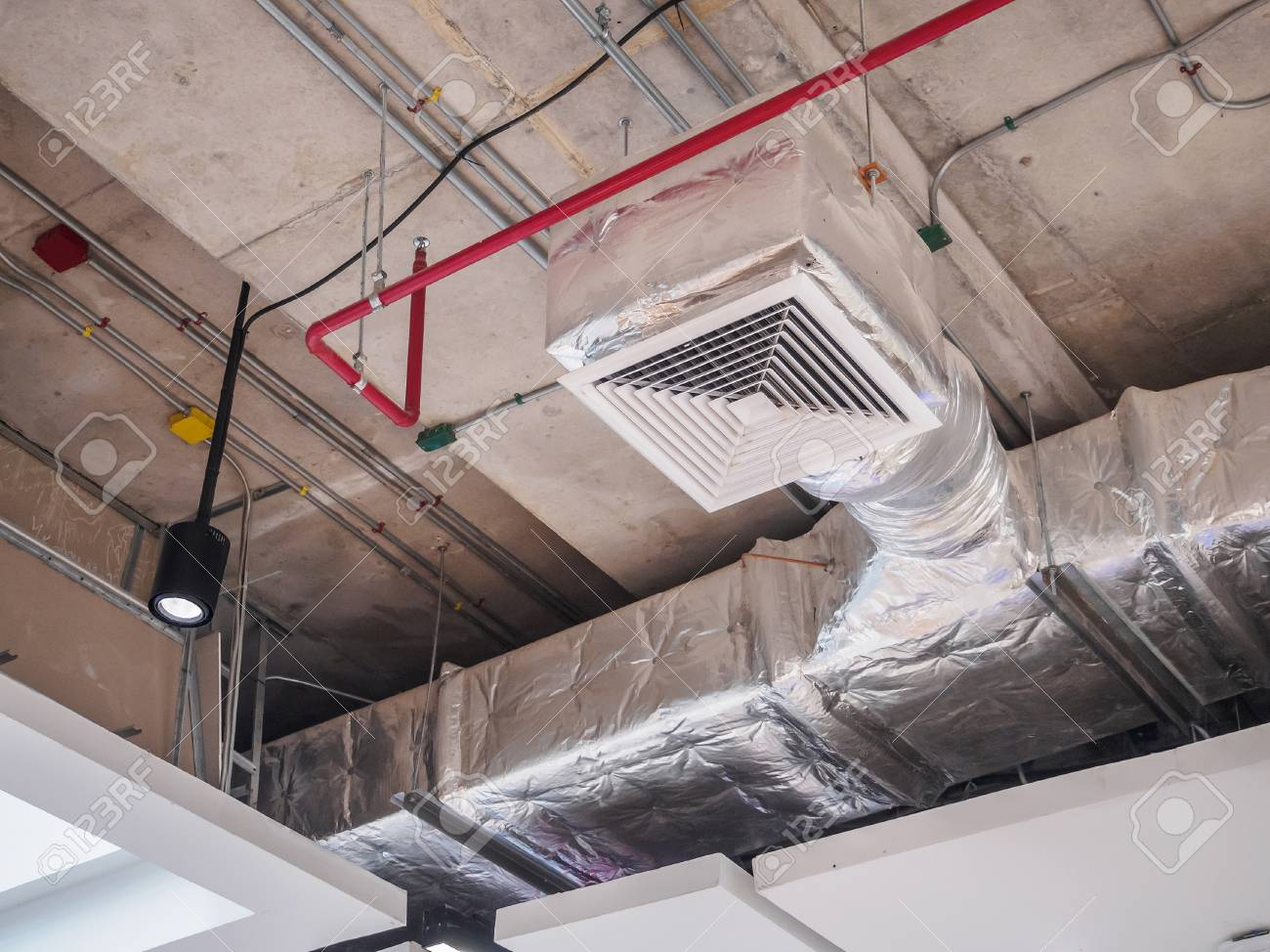 ventilation system ceiling air duct in large shopping mall stock