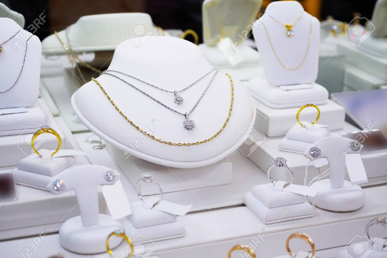jewelry diamond gold shop with rings and necklaces luxury retail store window display showcase - 89449450