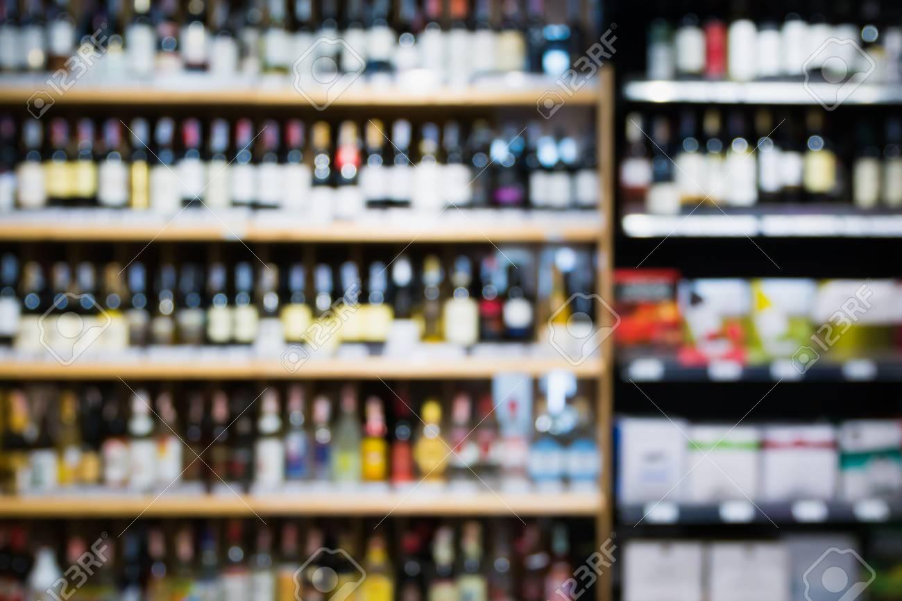 Abstract Blur Wine Bottles On Liquor Alcohol Shelves In Supermarket