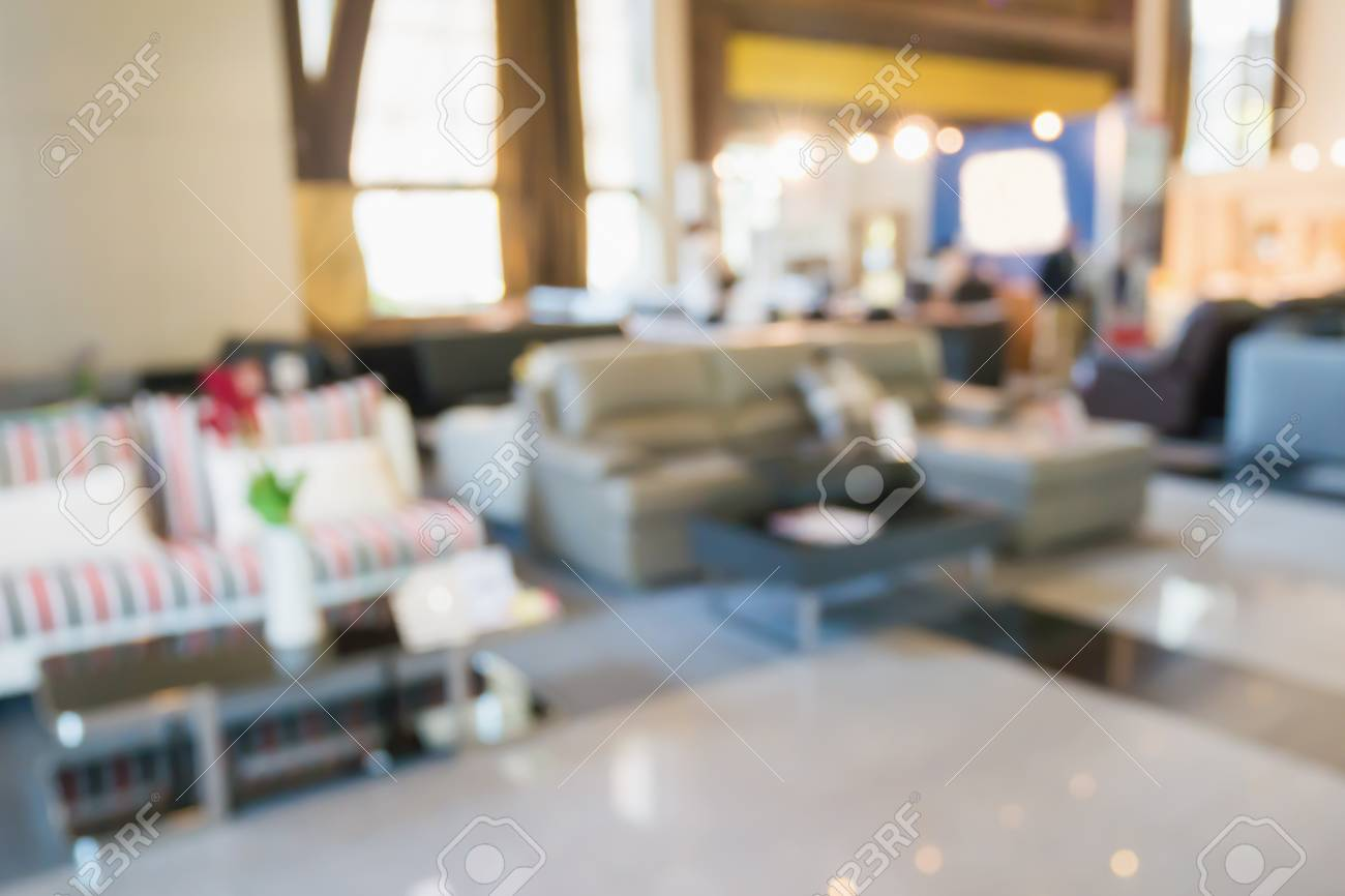 Abstract Blur Sofa In Home Decor Furniture Showroom Store Interior With  Bokeh Light Background For Montage