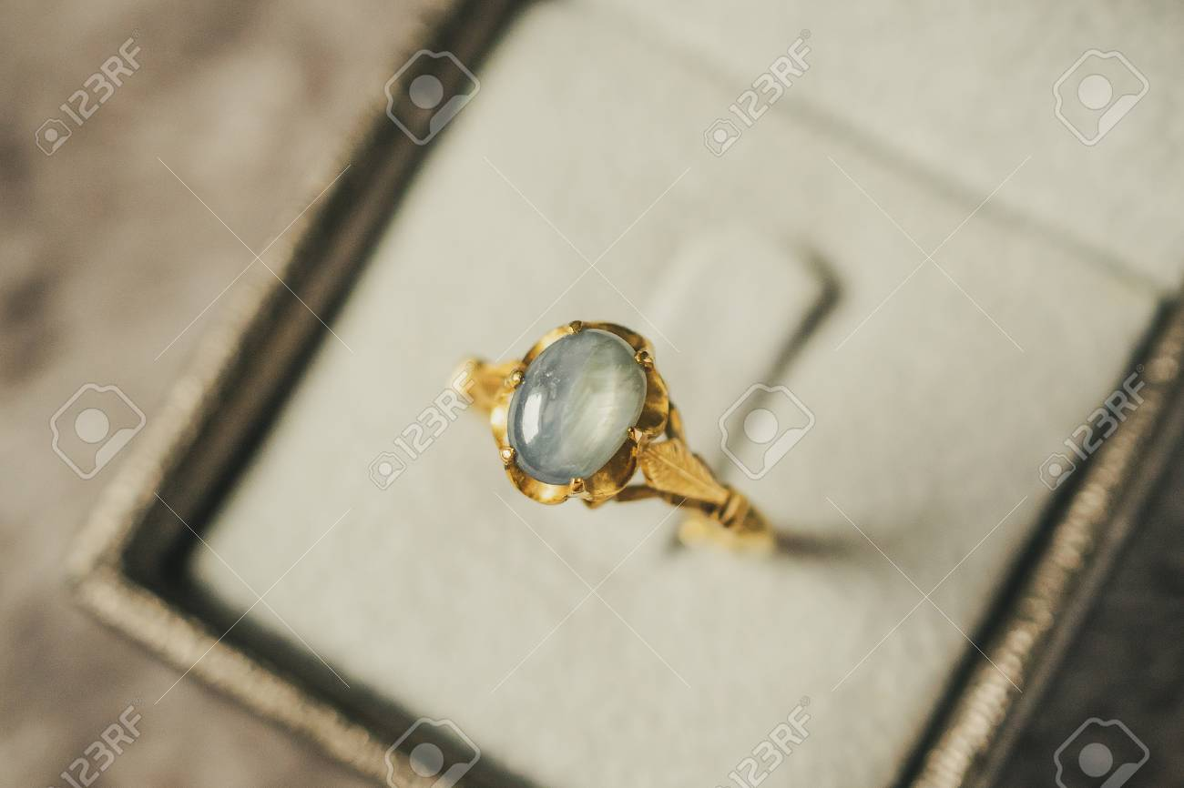Stock Photo - Vintage gold Jewelry blue sapphire ring in jewelry gift box