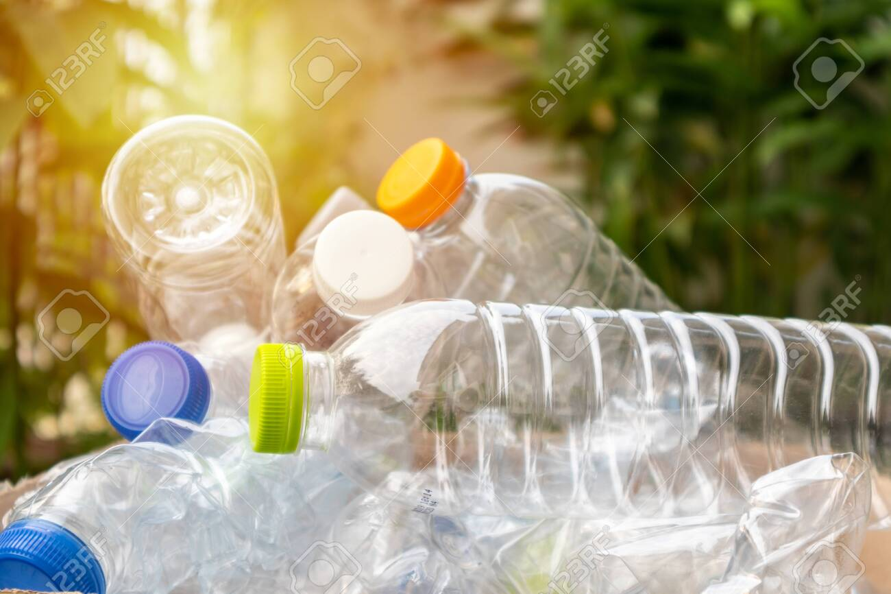 plastic bottles in brown recycle garbage box - 123513953