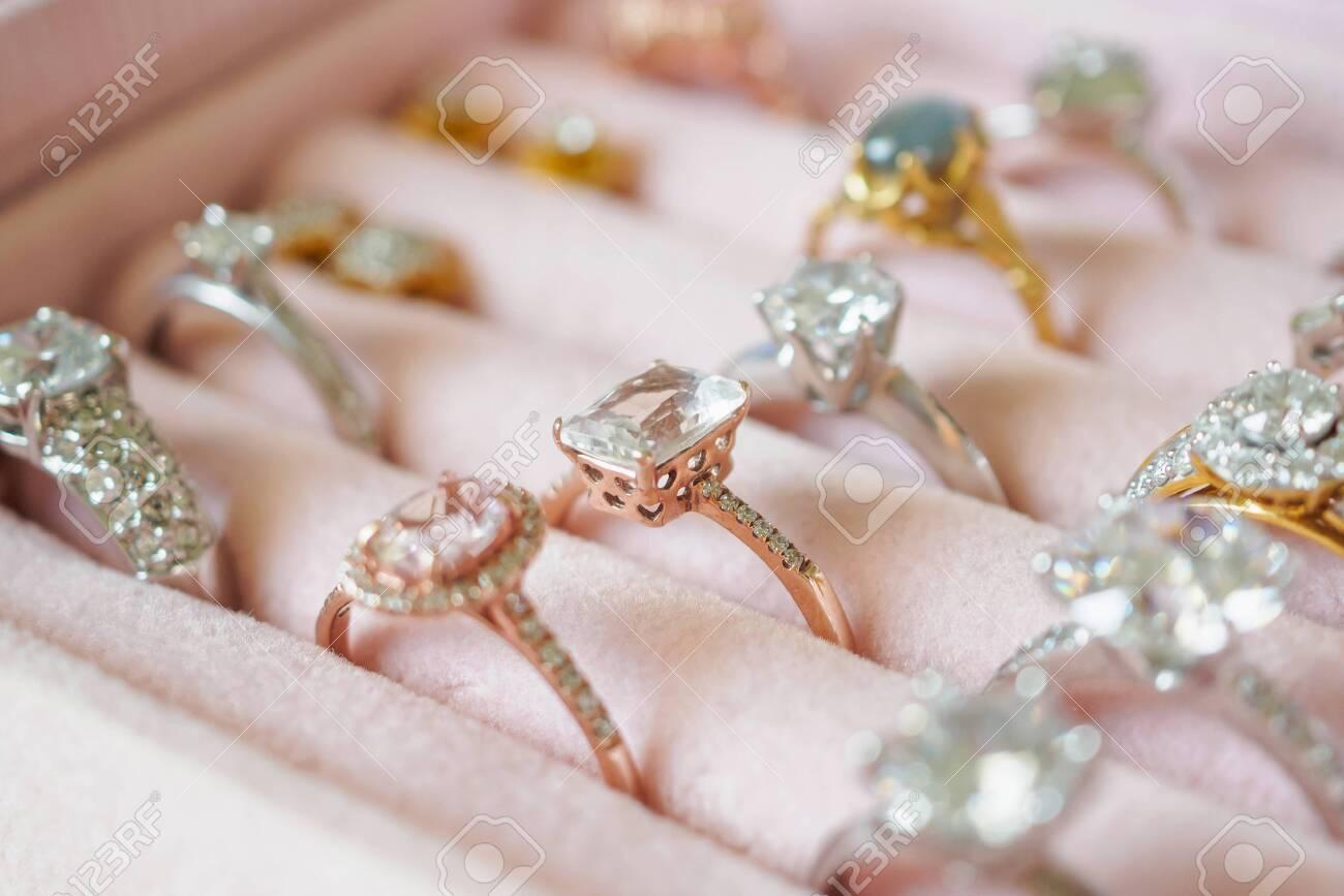 Jewellery diamond rings and earrings in box - 128758654