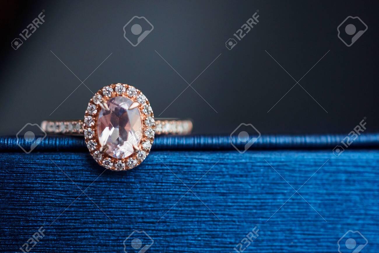 wedding gold diamond ring on jewelry box - 133424084
