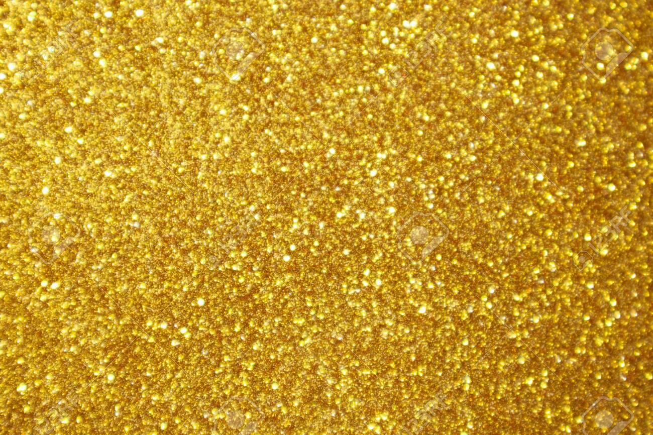 Abstract gold glitter sparkle bokeh light background - 133983071