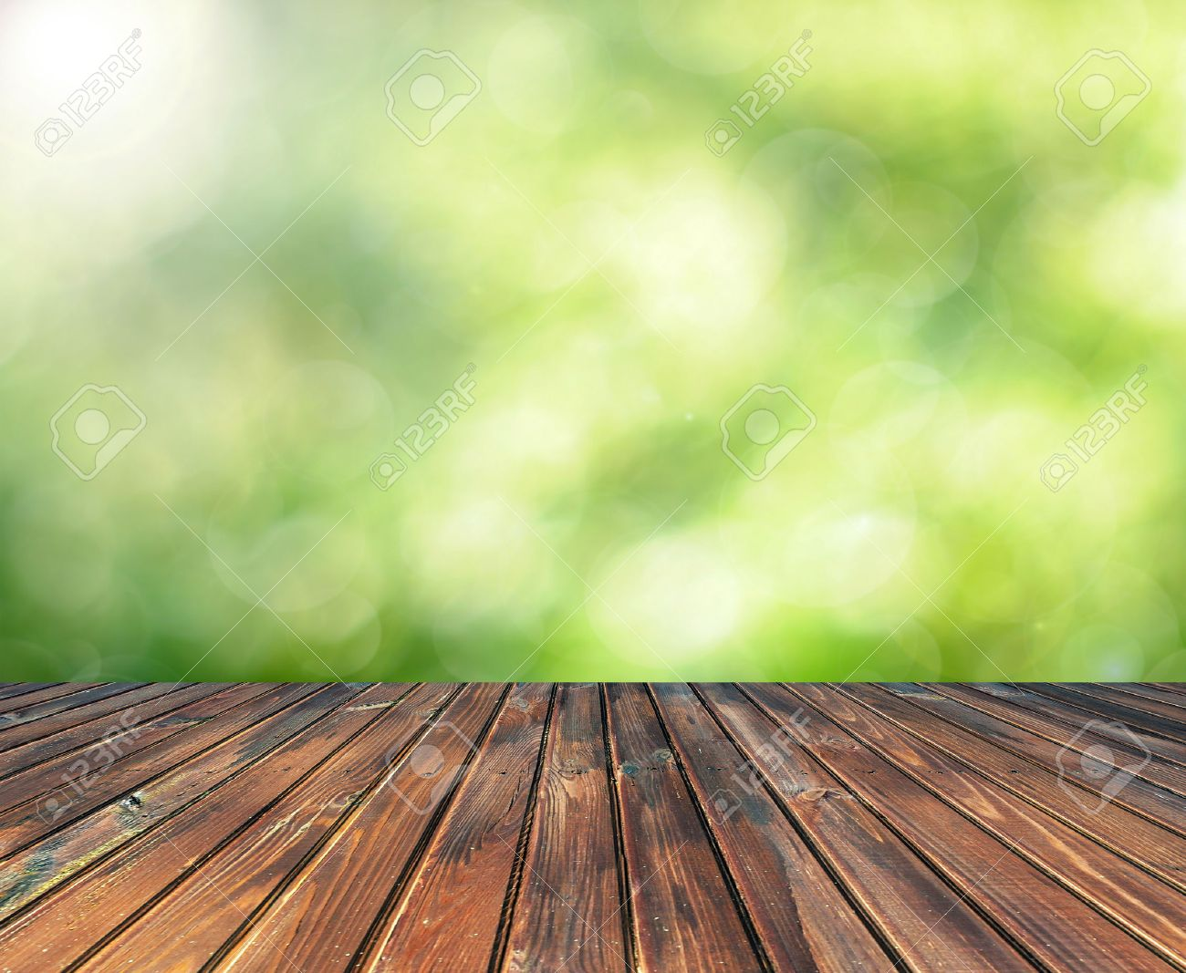 Wood table background hd - Wooden Table With Space For Your Photo Montage And Green Color Of Background Stock Photo
