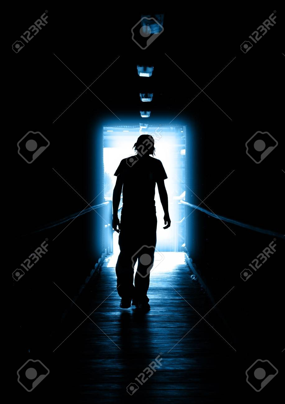 Young Man walking out of the light Stock Photo - 513559