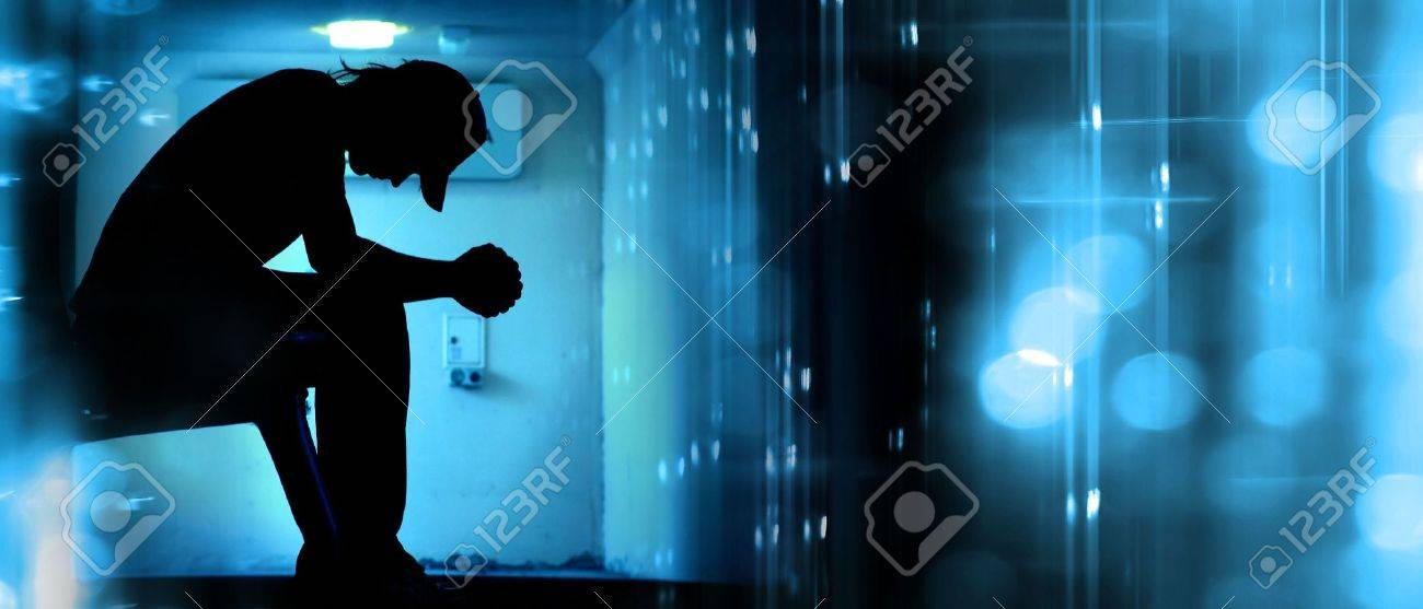 Silhoutte of desperate teenager praying on abstract background Stock Photo - 1092997