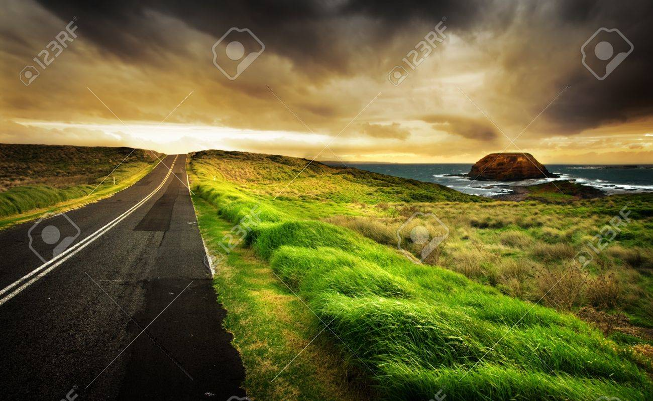 Road leads to a beautiful coastline Stock Photo - 7689596