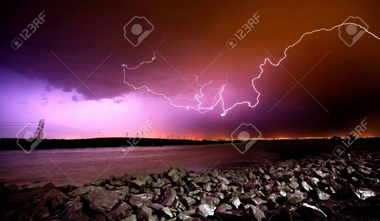 LIghtning Strikes over rocks and water Stock Photo - 9544984