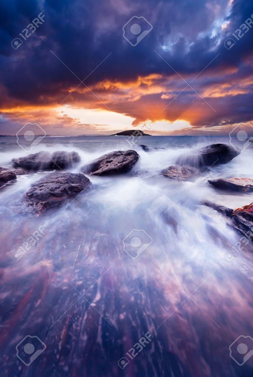 Gorgeous sunset over crashing waves Stock Photo - 13916859