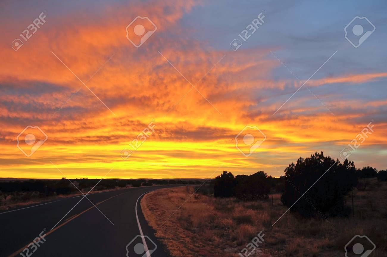 Road towards dramatic colorful sunset Stock Photo - 10466013