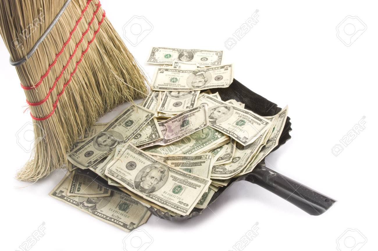 Broom sweeping up American Money Standard-Bild - 23789697