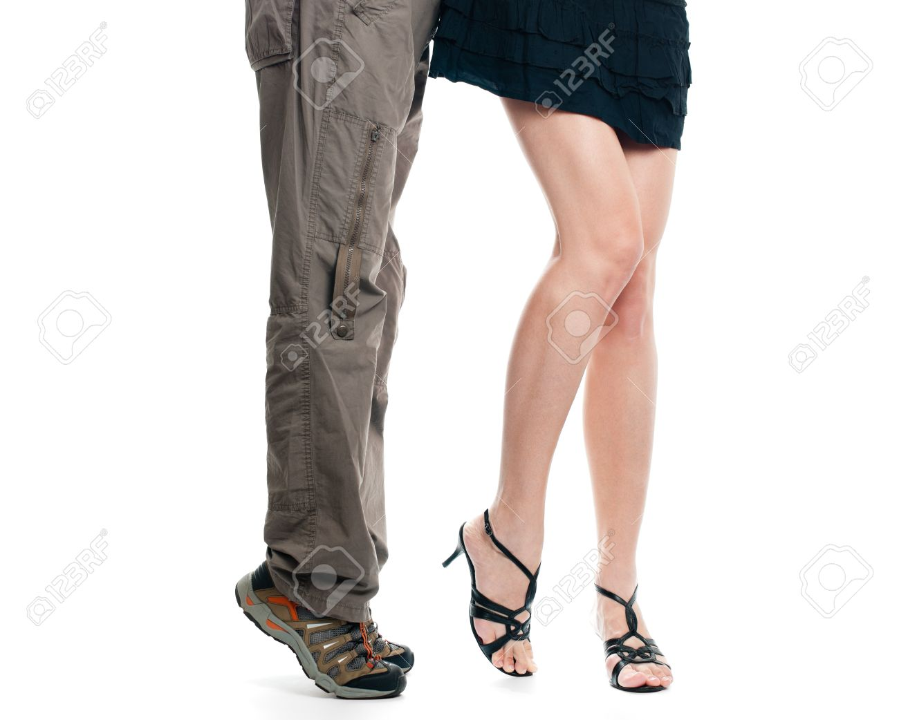 male and sexy female lower body parts isolated on white background. Man on his tiptoes trying to kiss girl Stock Photo - 8094692