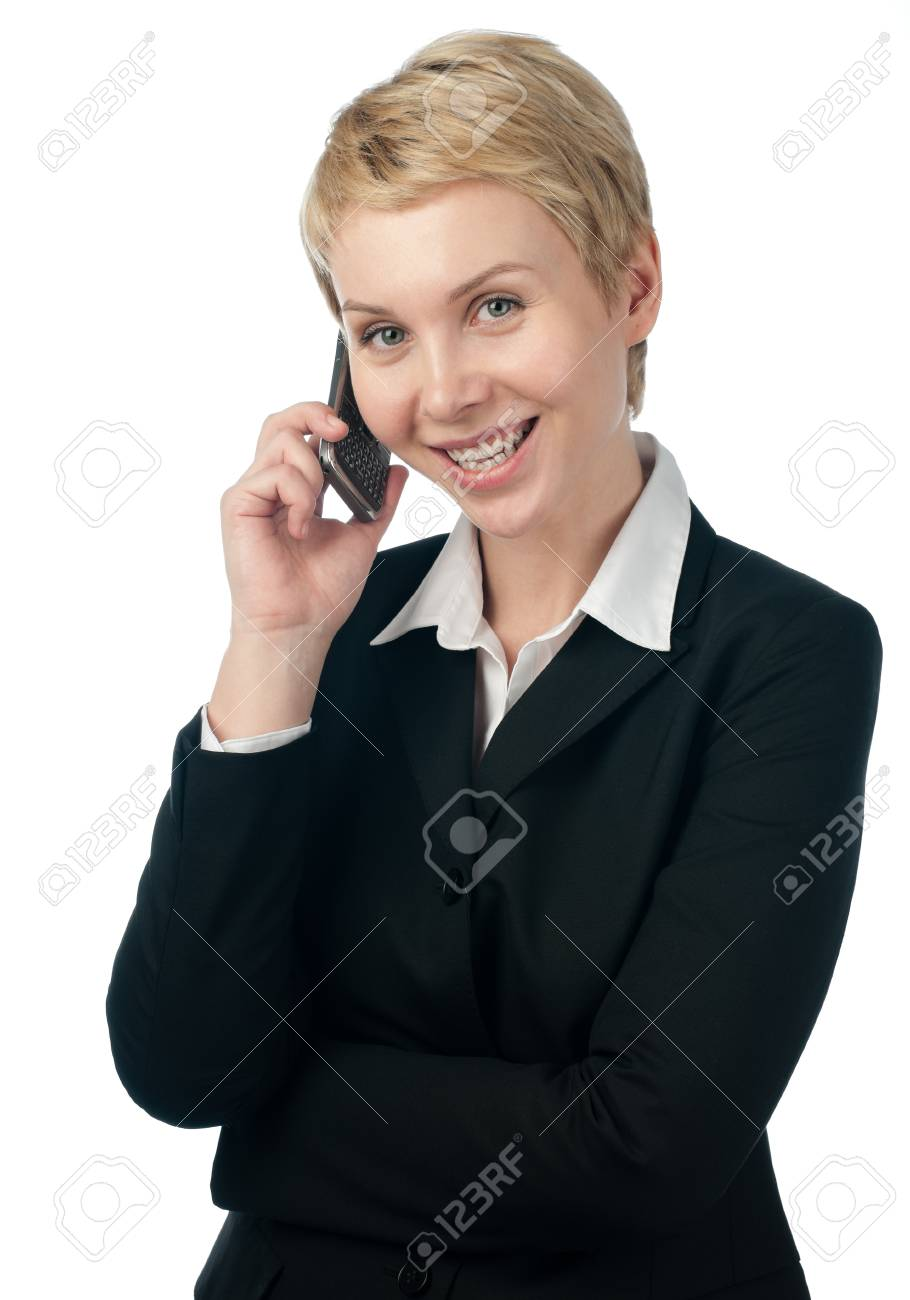 beautiful and young business woman, smiling and looking into the camera, talking on mobile phone. Isolated on white background Stock Photo - 9007152