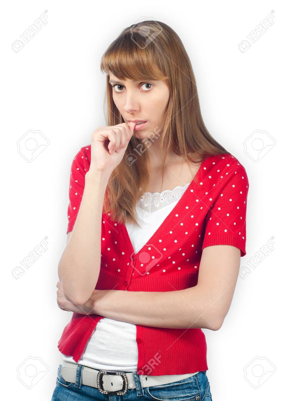 Beautiful worried young woman looking into the camera, finger at her mouth. Isolated on white background. Stock Photo - 15183675