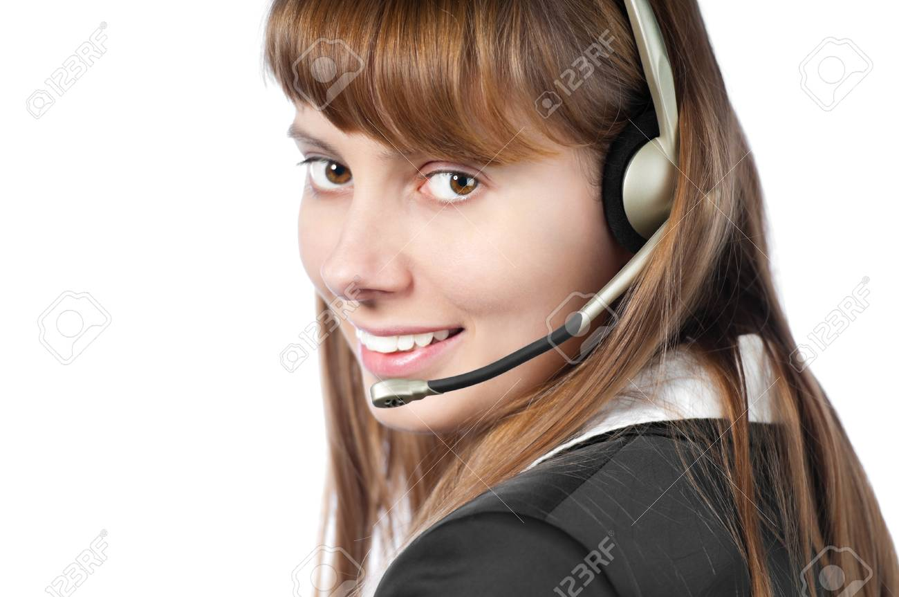 beautiful and happy young woman helpdesk operator. Headset on her head. Smiling and looking into the camera. Isolated on white background. Stock Photo - 14854582