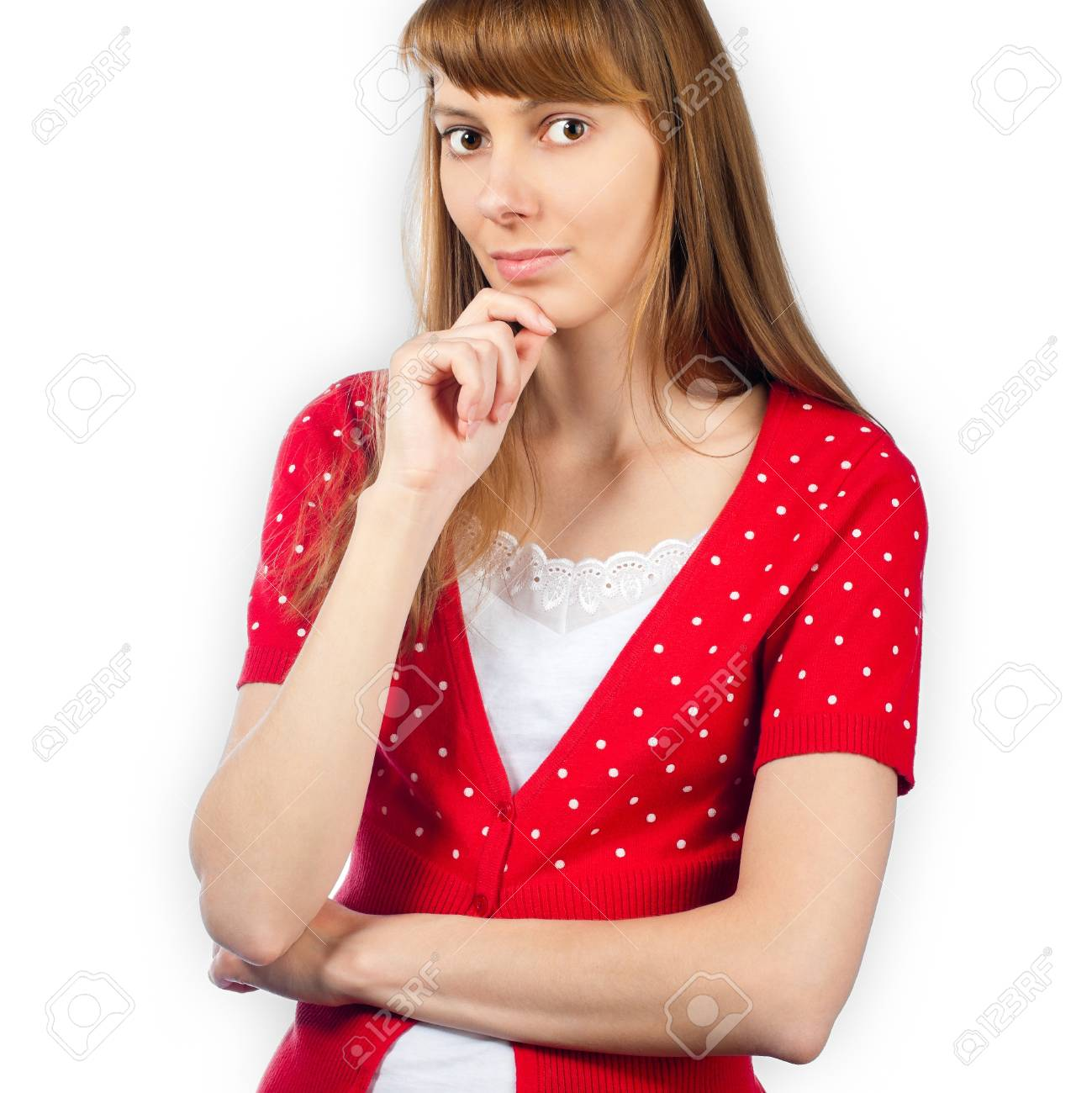 positive and beautiful young woman thinking, hand under her chin, looking into the camera. Isolated on white background. Stock Photo - 14848591