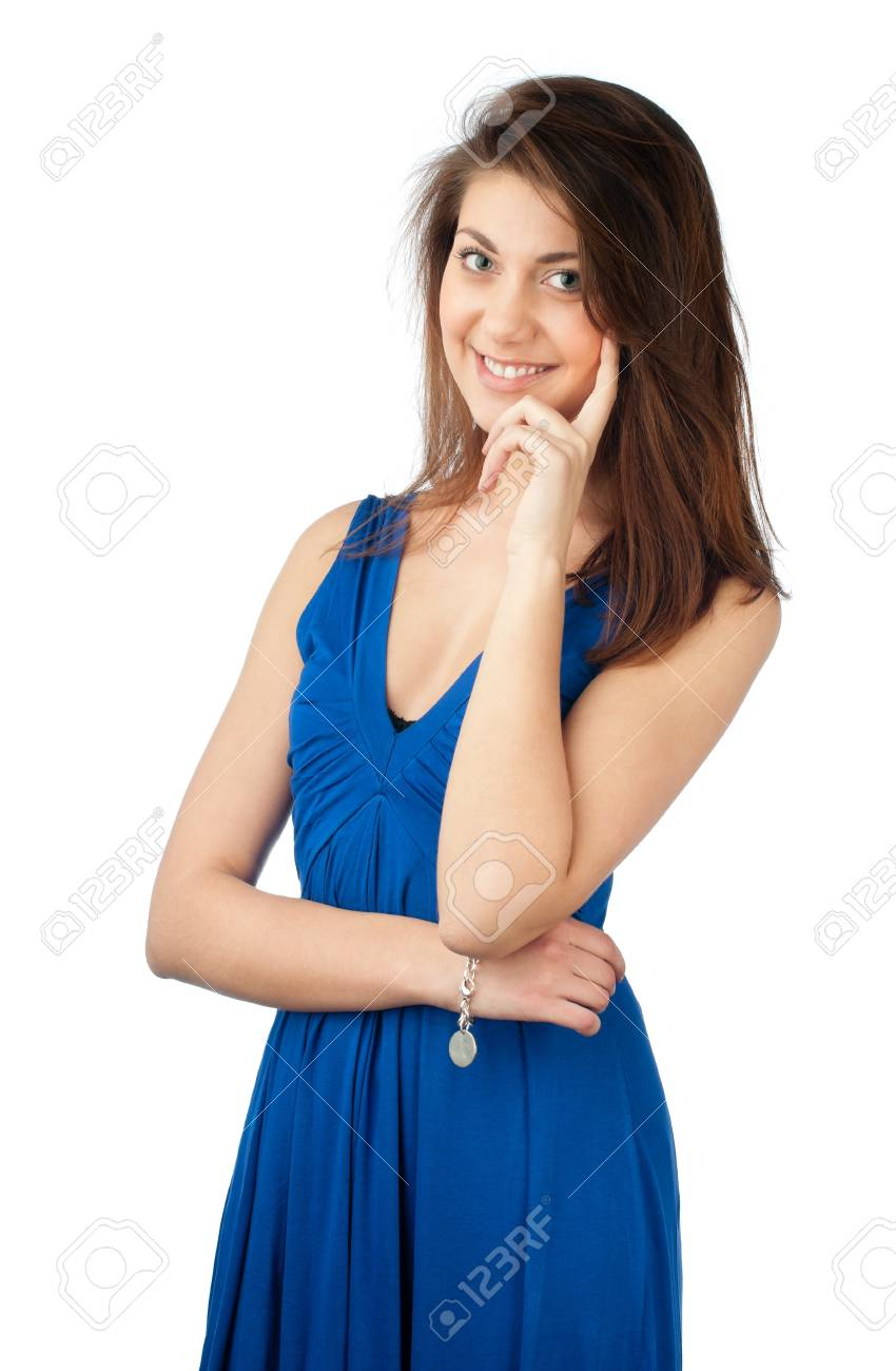 395924736 Aislado sobre fondo blanco. Mujer joven y bella y sexy con el pelo oscuro  en vestido azul. Mirando a
