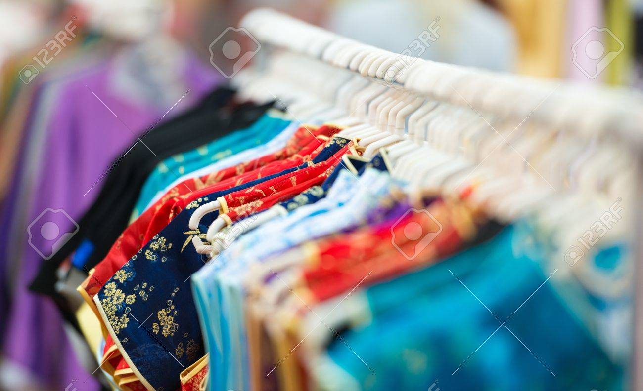 Rows of new colorful clothing on hangers at shop in foreground and background Stock Photo - 18424982