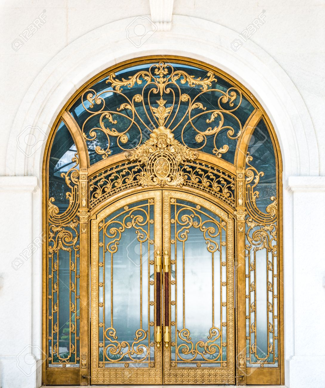 Door Made Of Wood Gold And Glass Reflecting Arch White