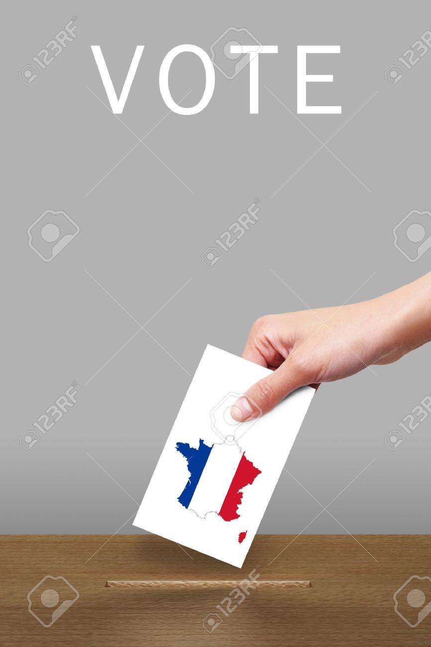Hand with ballot and wooden box on Flag of France Stock Photo - 12861329