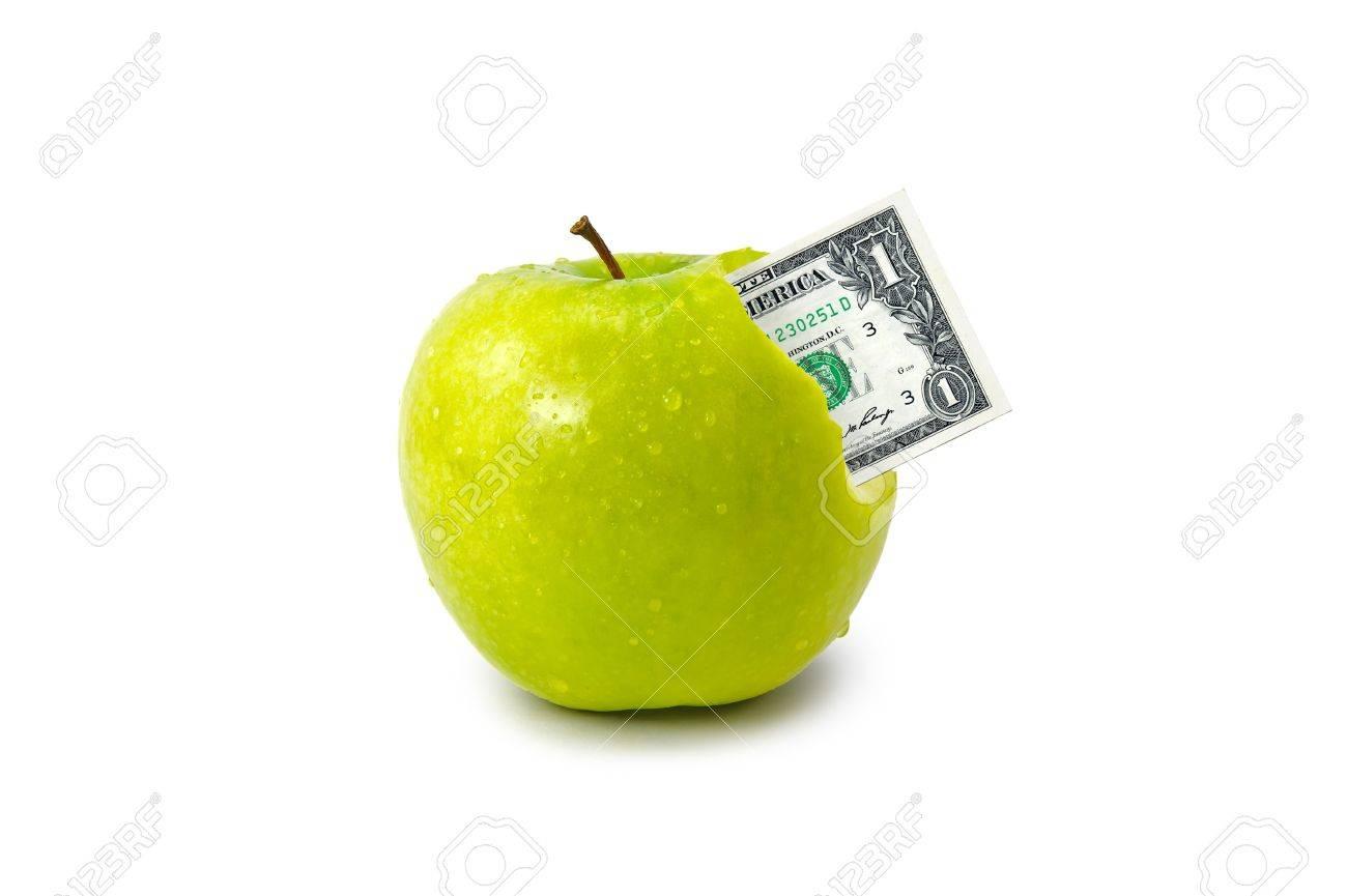 Dólar saliendo de manzana verde aislado sobre fondo blanco Foto de archivo - 13100630