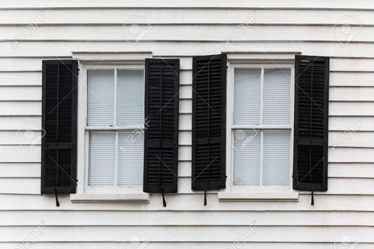Windows house open - Stock Photo Two Shut Windows With Open Blinds On A Wooden House