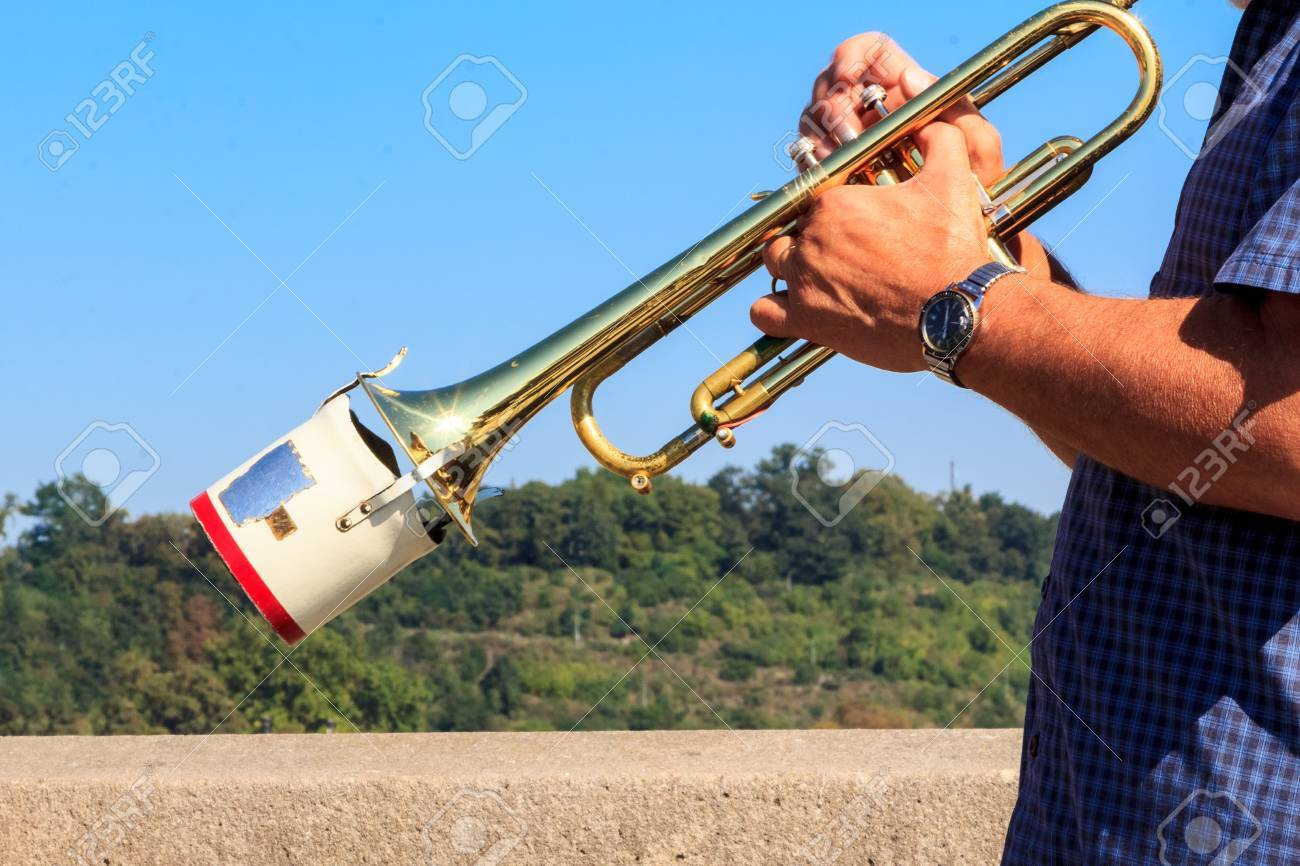 A trumpet played in open air with a metal muffler Stock Photo - 26885221