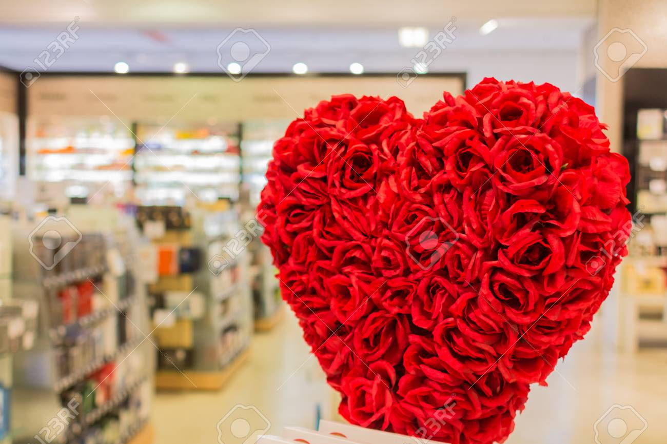 A Heart Shaped Flower Bouquet In Front Of A Store Stock Photo ...