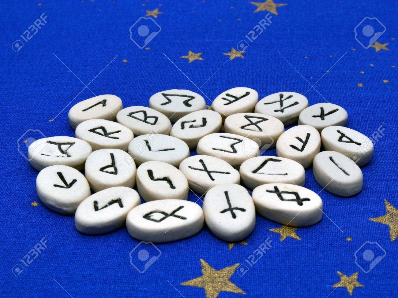 A collection of Norse rune stones, used in divination and magic Stock Photo - 16422761