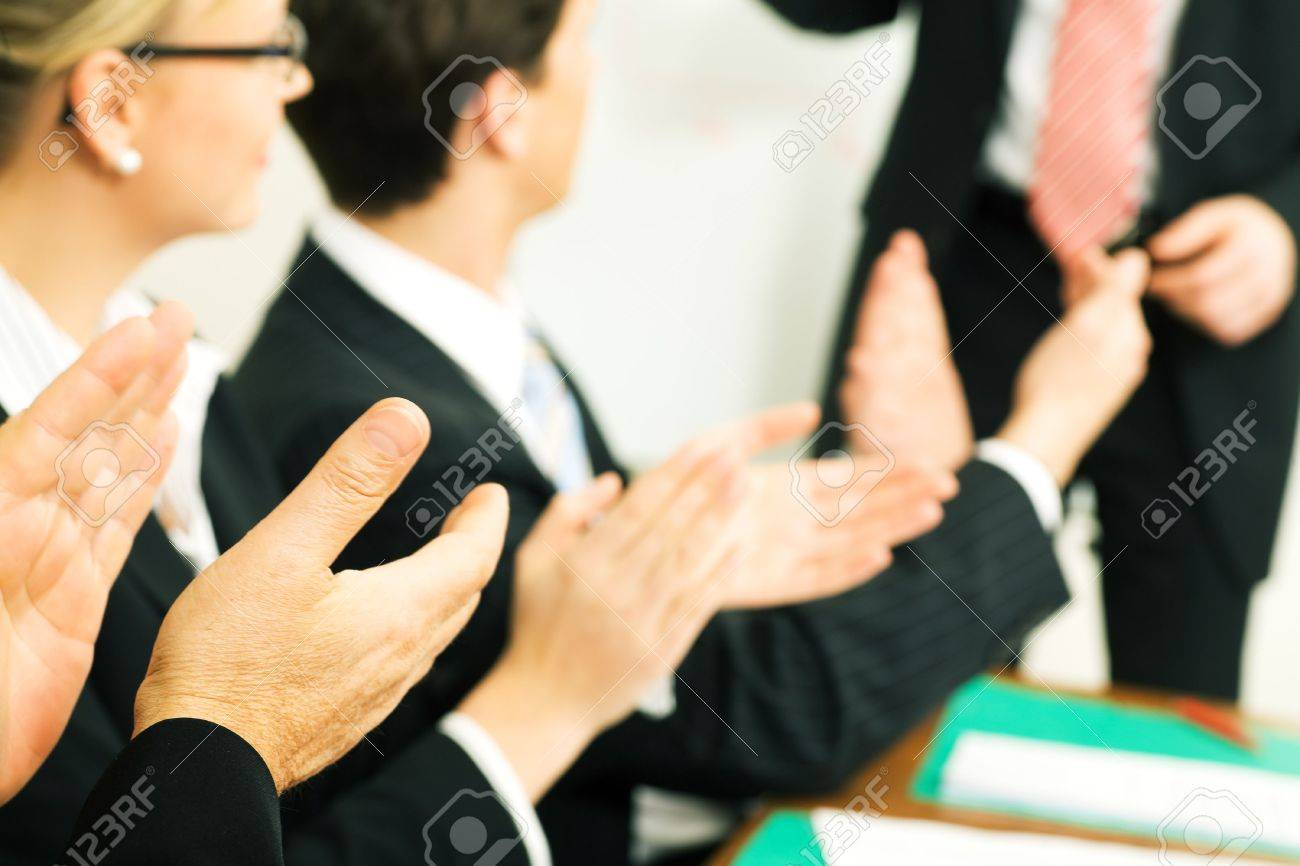 Business team applauding after a successful business presentation (selective focus only on hand in front!) Stock Photo - 3614171