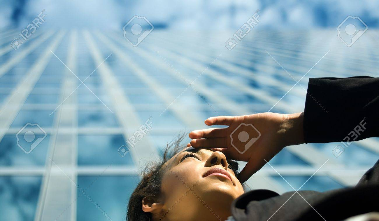 A young professional woman looking far away in front of a modern office building, presumably at new career options Stock Photo - 3623655