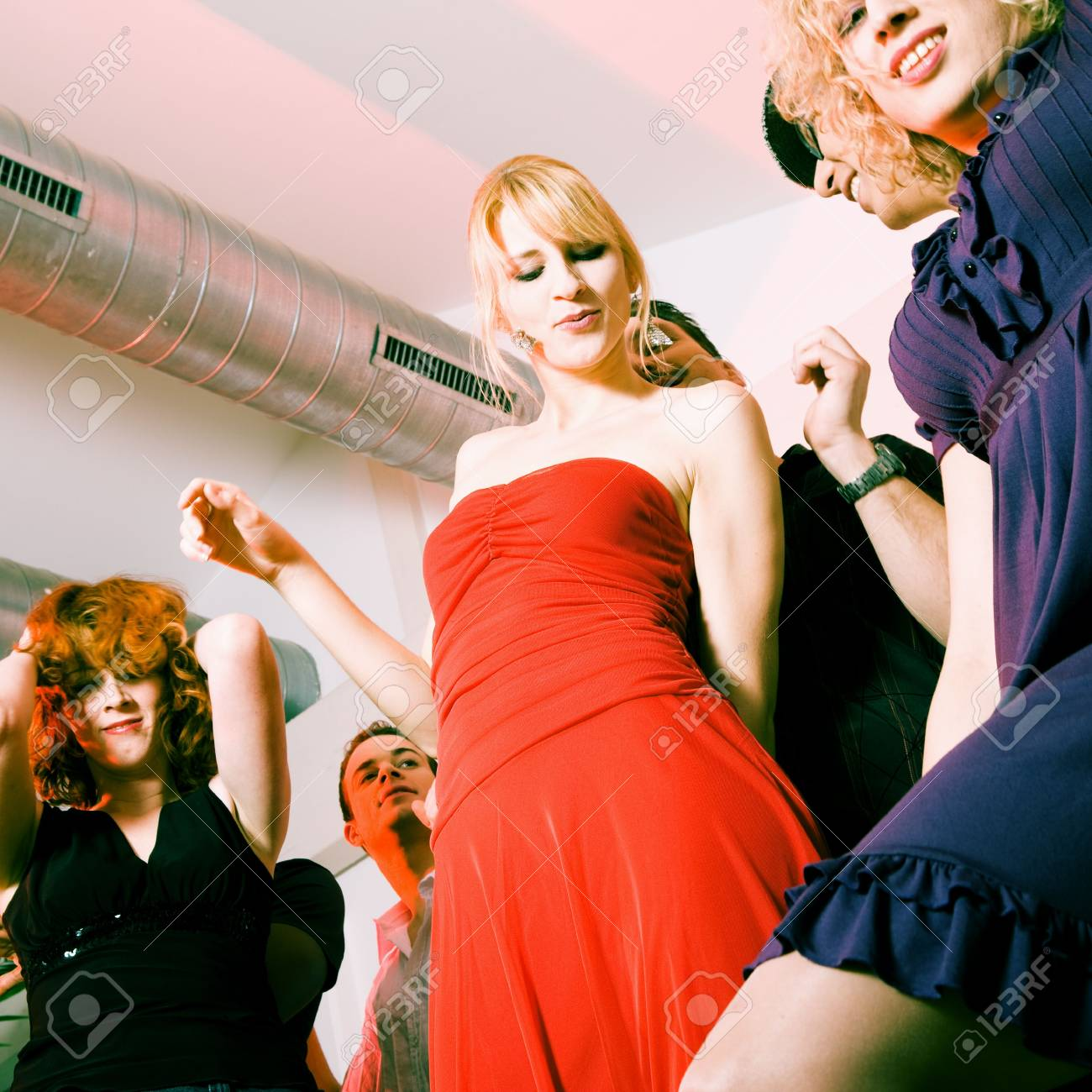 Crowd of people dancing in a disco club having a great party Stock Photo - 6081992