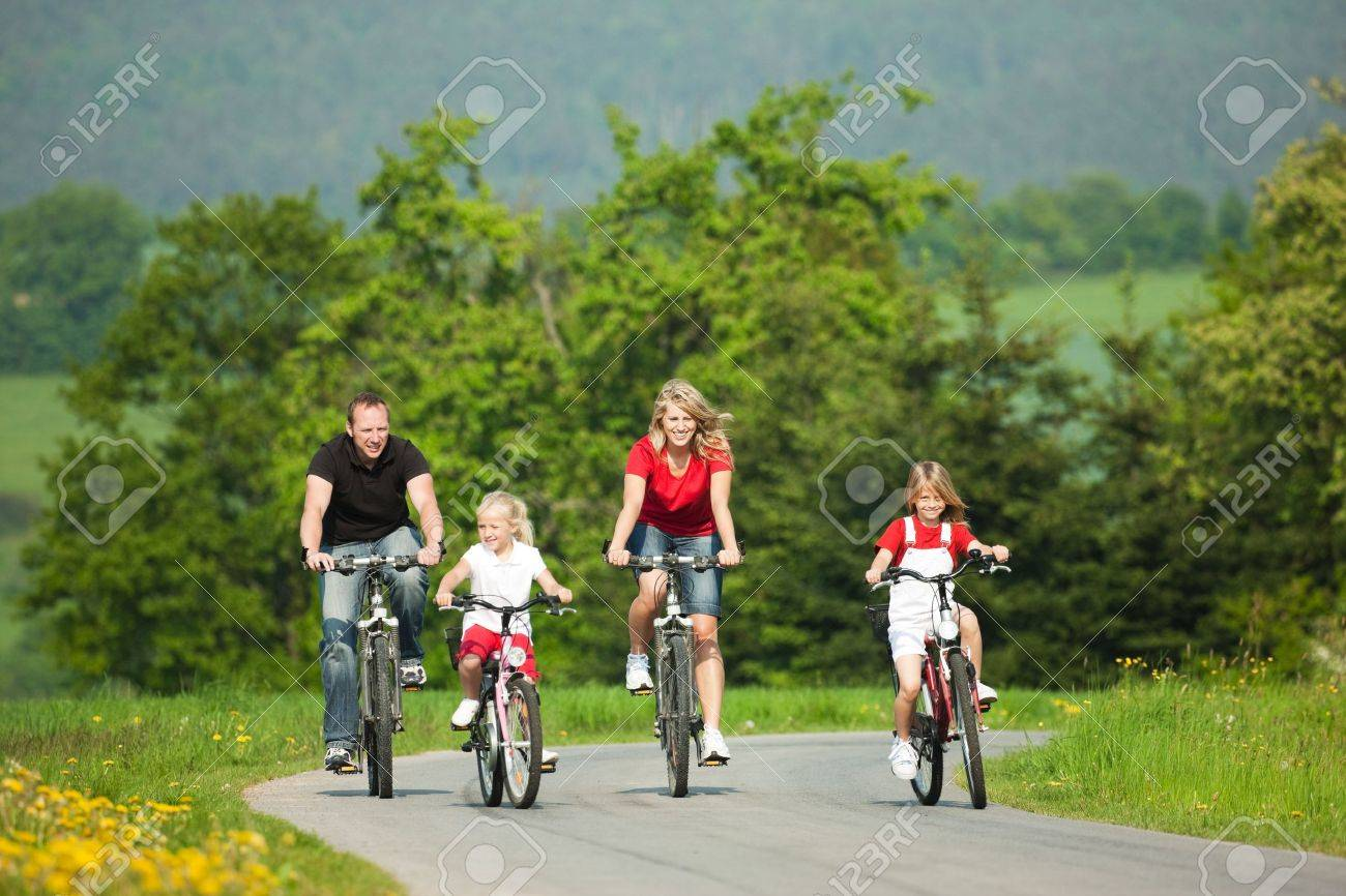 Family with children having a weekend excursion on their bikes on a summer day Stock Photo - 6092652