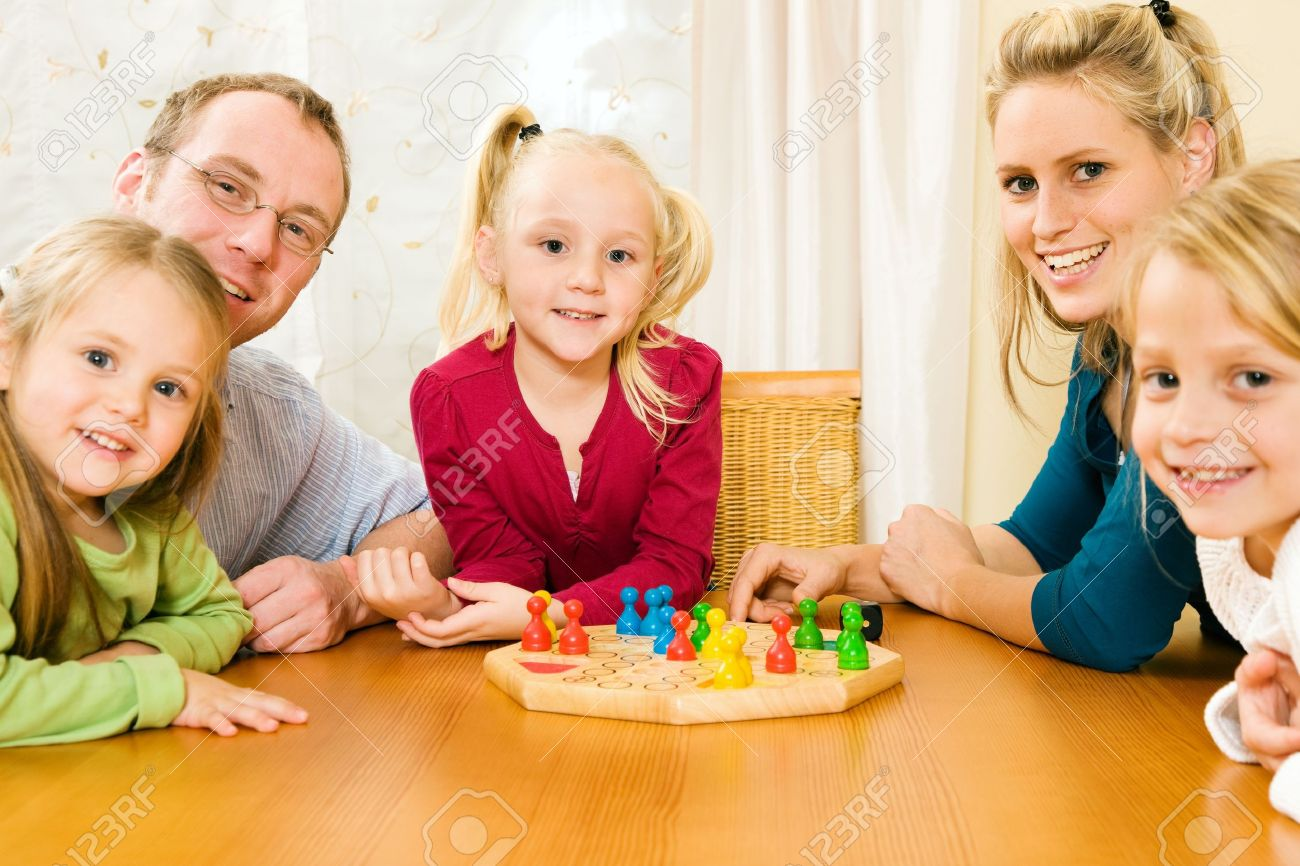 Family Playing A Board Game Stock Photo Picture And Royalty Free