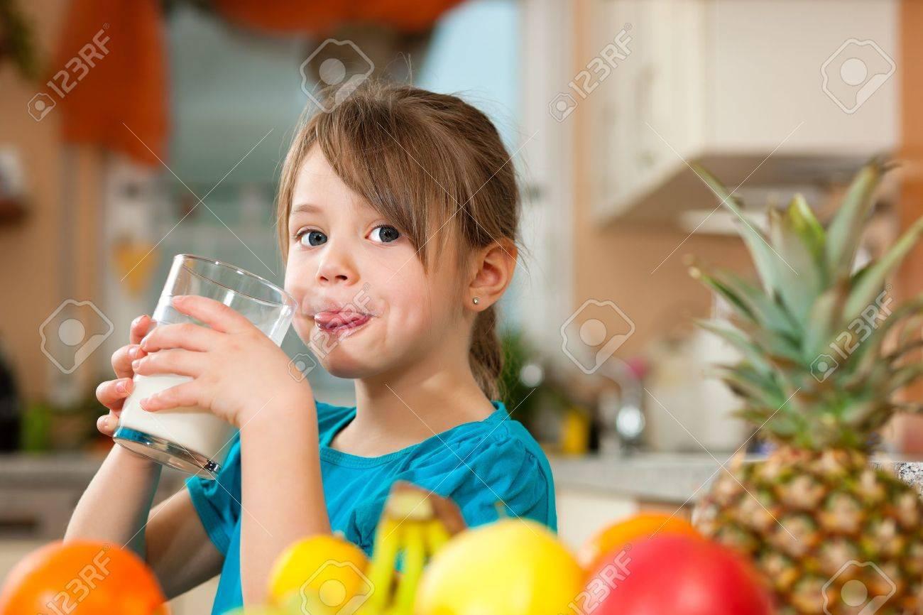 Child drinking milk Stock Photo - 9415552